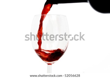 Red wine poured into a glass isolated on white background - stock photo