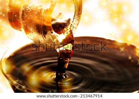 Red wine pouring down from a wine bottle - stock photo