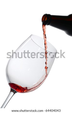 Red wine pouring down from a wine bottle