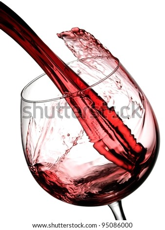 Red wine pouring in a glass, slow motion - stock photo