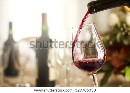 red wine pouring in a restaurant - stock photo