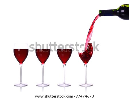red wine pouring in glass isolated on white - stock photo