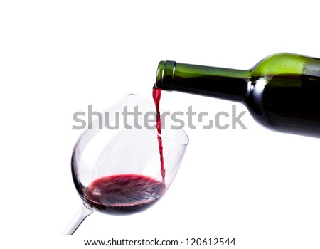 red wine pouring in the glass isolated over white background - stock photo