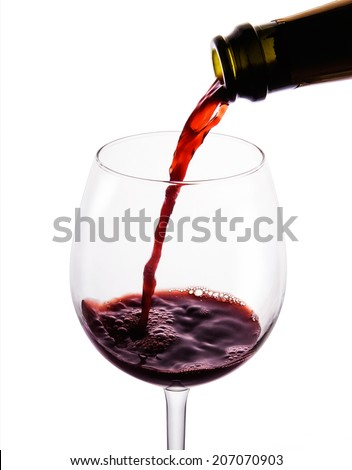 Red wine pouring in to the beautiful wine glass. Isolated on white with Clipping path.