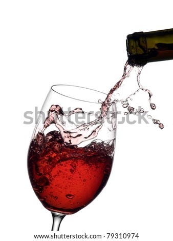 Red wine pouring into a wineglass  from a bottle with splashing - stock photo