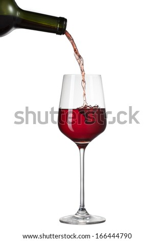 Red wine pouring into glass with splash isolated on white - stock photo