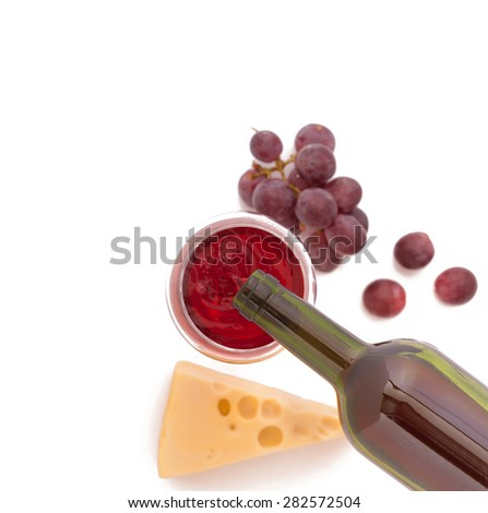 Red wine pouring into wine glass, close-up isolated. Flat mock up for design - stock photo