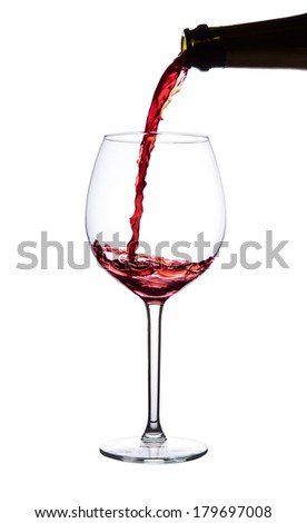 Red wine pouring into wine glass. isolated with clipping path.
