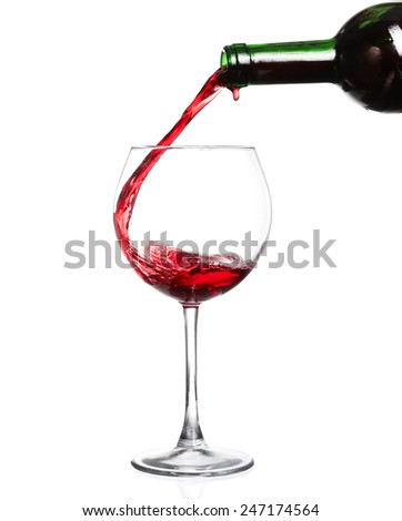 Red wine pouring on white background