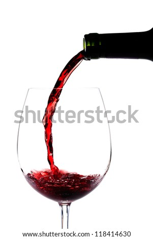 Red wine pouring splashing on a glass on white - stock photo