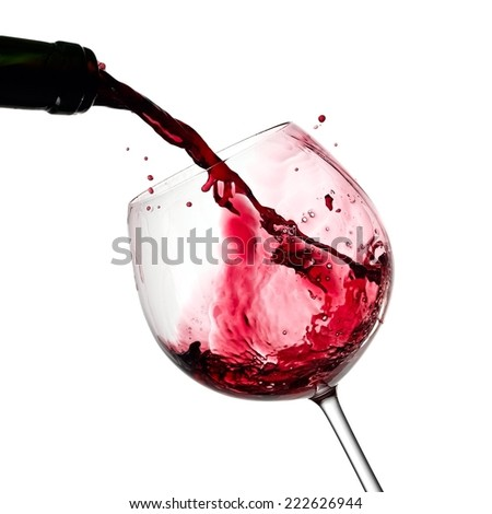 Red wine pouring with drops - stock photo