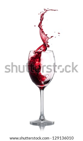 Red wine splash over white background - stock photo