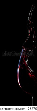 red wine splash silhouette isolated on black background - stock photo