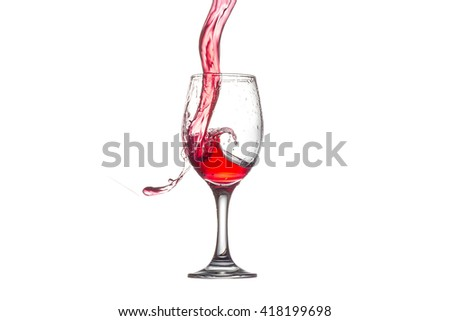 red wine splashing in wine glass on white background.