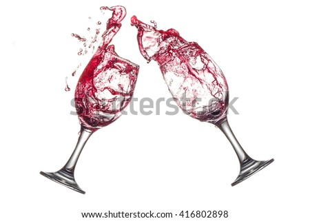 red wine splashing in wine glasses on white background isolated. - stock photo