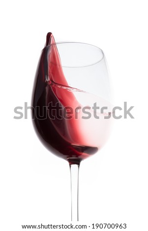 red wine splashing out of a glass, isolated on white