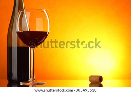 Red wine - still-life with glass and bottle with big space for text - stock photo