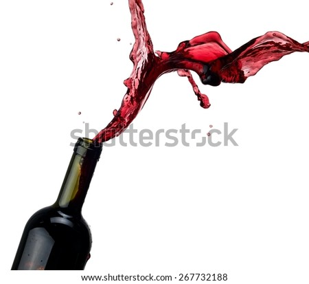 Red wine up and splash from a bottle - stock photo