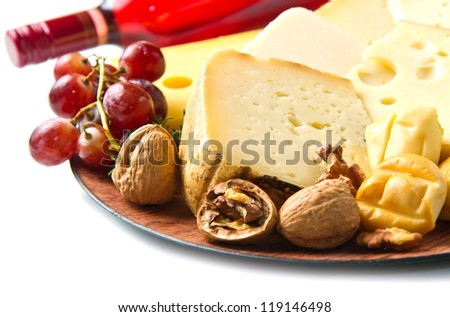 Red wine with  cheese selection over white - stock photo