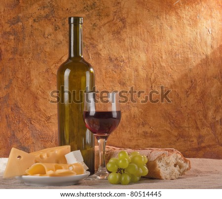red wine with different sorts of cheese