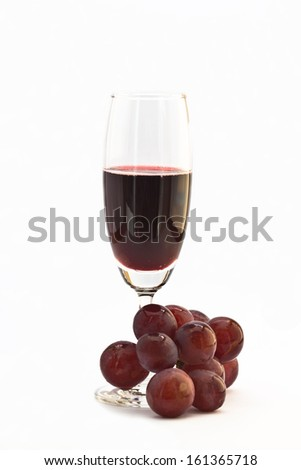 Red wine with fresh grapes on white background