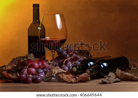 red wine with grape and vine leaves