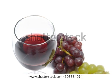 red wine with grapes - stock photo