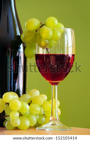 Red wine with grapes cluster - stock photo