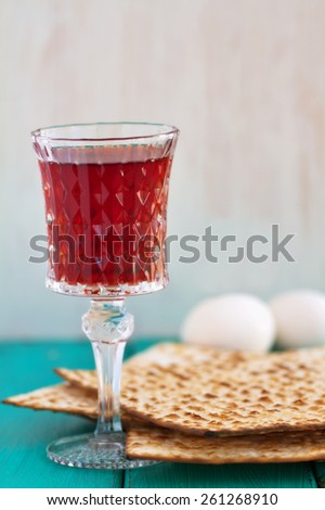 Red wine with Passover Matza on a vintage wood background - stock photo