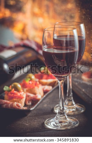 Red wine with tapas on crusty bread