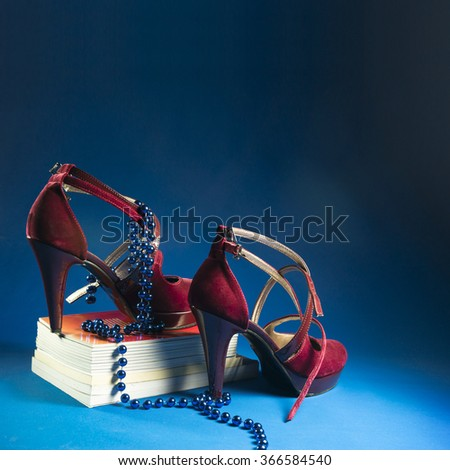 Red woman high heels summer and business shoes on blue backgrounds - stock photo