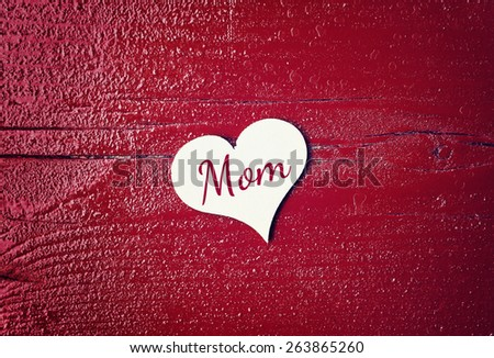 red wood background with hearts - mom - stock photo