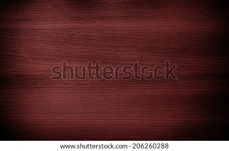 Red wood texture background. Shadow and vignette effect. - stock photo