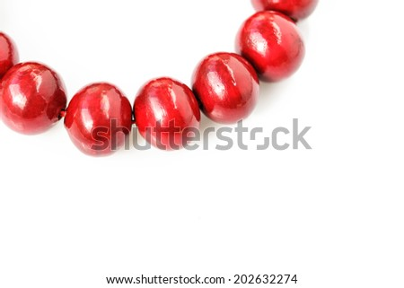Red wooden beads isolated on a white background