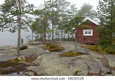 red wooden cabin - stock photo