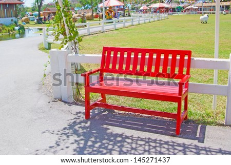 Red wooden chair on the park.
