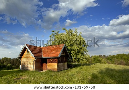 red wooden cottage and beauty sky