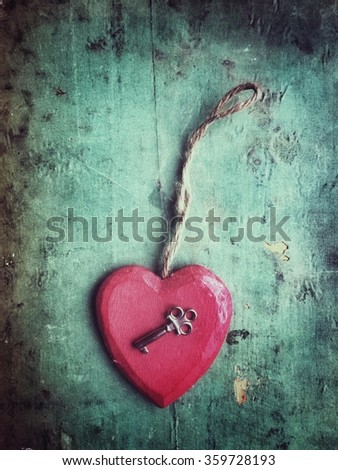 Red wooden heart and a key