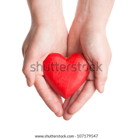 Red wooden heart in woman's hands isolated on white