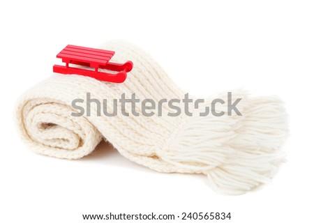 red wooden sledge christmas souvenir on the white scarf mountain - stock photo