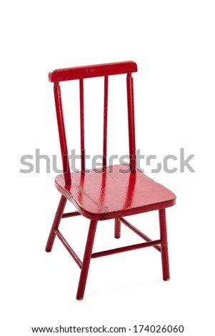 Red wooden vintage childs chair isolated on white background