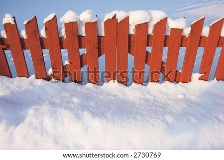 Red wooden wall. Winter. - stock photo