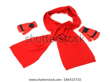 Red wool scarf, a pair of gloves nicely arranged. Winter accessories isolated on white background. - stock photo