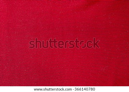 Red woolen sweater background texture close up - stock photo