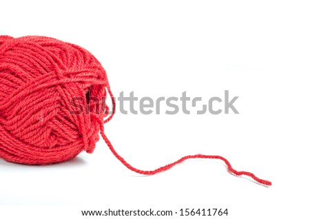 Red woolen thread from a yarn on white background - stock photo