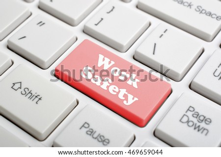 Red work safety key on keyboard