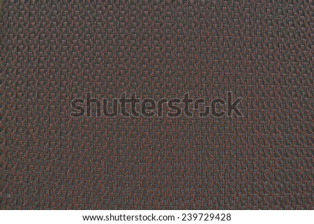 Red woven vinyl with dark lines. The background texture. - stock photo