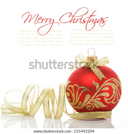 Red xmas ball and golden ribbon on the white - stock photo