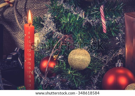 Red Xmas candle counting down for Christmas - stock photo