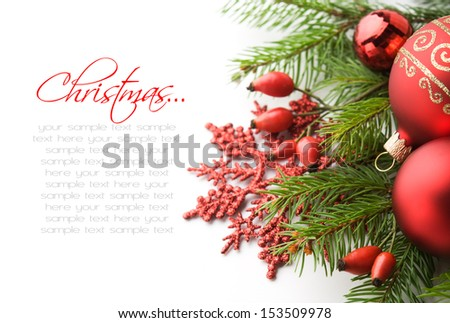 Red xmas decorations on white background with copy space - stock photo